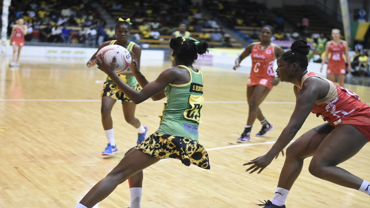 Jamaica's Shantal Slater looks for a pass during Game 1 of the three-match netball series against England at the National Indoor Sports Centre on Thursday night. Jamaica won 55-43. (PHOTOS: Marlon Reid).