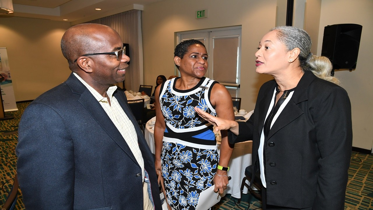 Curtis Martin (left), managing director, JN Bank and Janelle Brown (second left), Marketing and Sales Manager, WIHCON, listen keenly as Frances Ross, Business Relationship Manager, JN Bank Developer/Real Estate Affiliate Programme, makes a point, during a recent breakfast meeting with developers and realtors at the Courtyard Marriot in New Kingston.