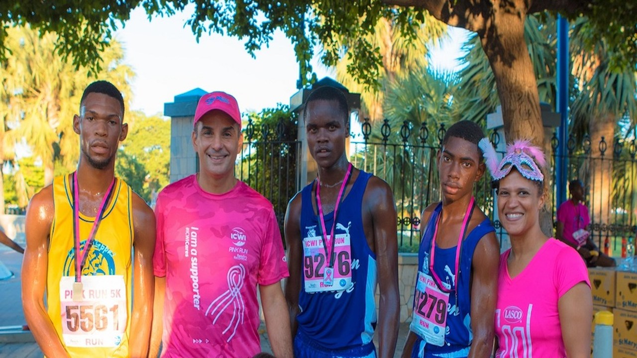 President of ICWI Paul Lalor (second left) poses with the top three male finishers (left to right) at 2018 ICWI/Jamaica Reach To Recovery Pink Run Garfield Gordon, Tanny Aaarons and Kurt Dawkins along with LASCO marketing manager-beverages Danielle Cunningham at the run held on Sunday, October 28 in New Kingston.