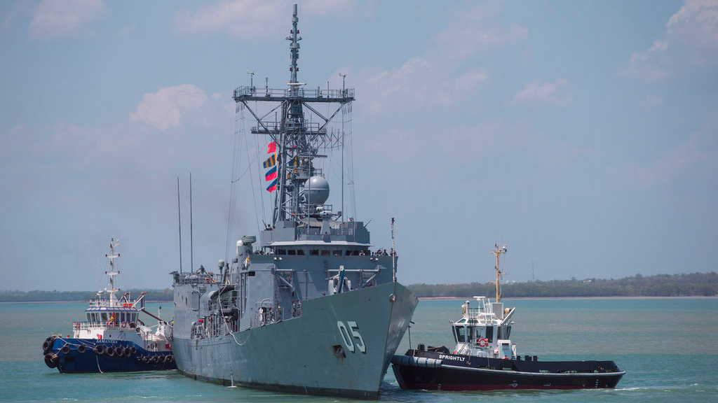 In this Sept. 13, 2018, file photo, guided missile frigate HMAS Melbourne leads the fleet back to harbour following Exercise KAKADU, Australia's largest maritime exercise, in Darwin, Northern Territory. Australia has assigned the guided missile frigate to the East China Sea to boast international efforts to enforce sanctions against North Korea, an Australian officer said on Friday, Oct. 12. (Glenn Campbell/AAP Images via AP)