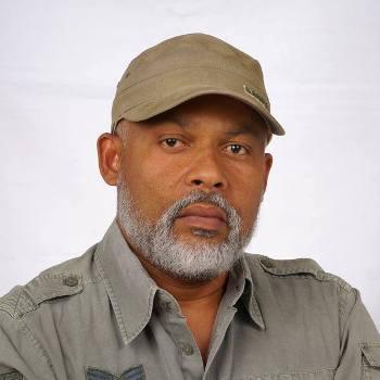 Eric Jean Baptiste, Homme d'Affaires et Secrétaire général du RDNP