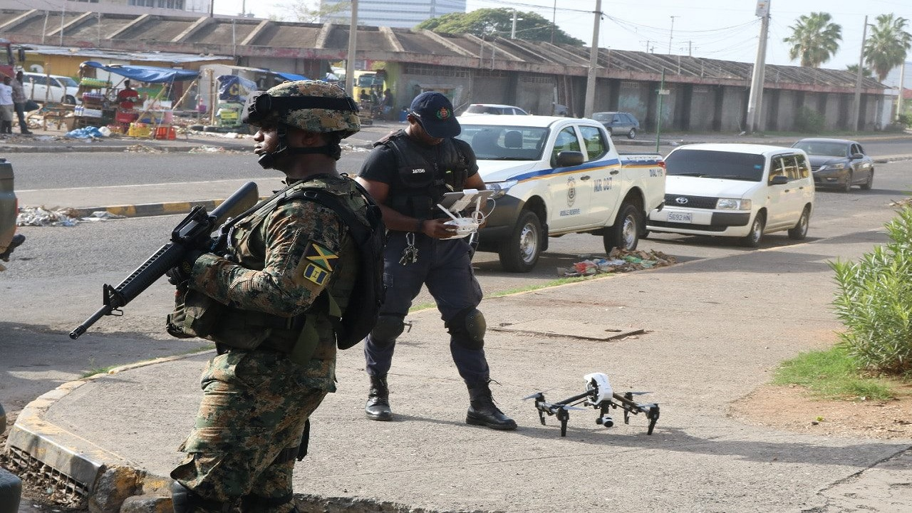 Members of the security forces in the downtown Kingston market district on Monday. (PHOTO: JCF)
