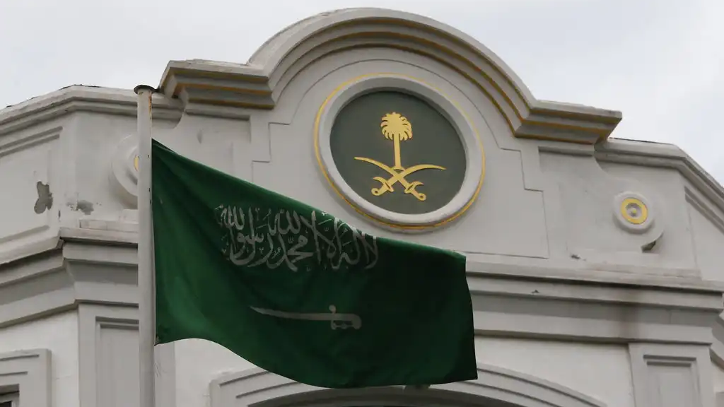 The Saudi Arabia flag flies outside the country's consul general's official residence in Istanbul, Wednesday, Oct. 24, 2018. (AP Photo/Lefteris Pitarakis)
