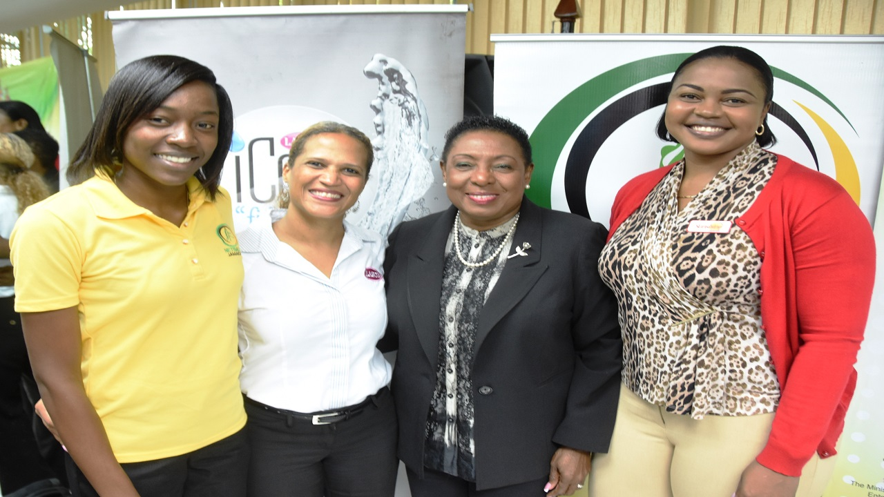 Sports Minister Olivia Grange (3rd left) poses for a picture with Sunshine Girl goal attacker Shanice Beckford (left), Lasco Beverages Marketing Manager Danielle Cunningham (2nd left) and Brand Manager of Sunshine Cereals Keisha Prince (right) at the launch of the Lasco Sunshine Series on Wednesday October 3, 2018 at the Ministry of Culture, Gender, Entertainment & Sports.