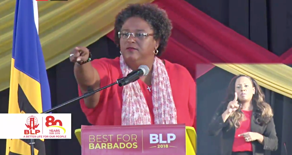 Prime Minister of Barbados Mia Mottley delivering her annual conference address. Bonnie Leonce (inset)