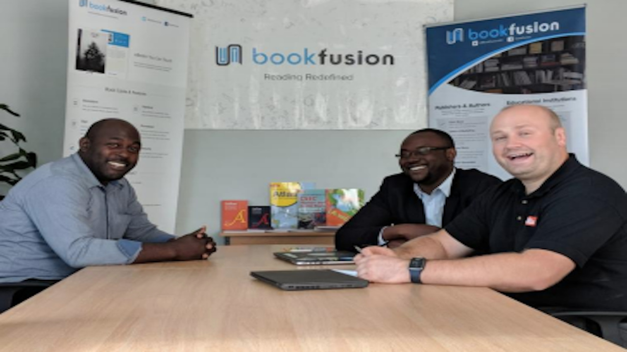 (from left) Kevin Fullerton, marketing representative (Jamaica) for Collins; Dwayne Campbell, CEO BookFusion