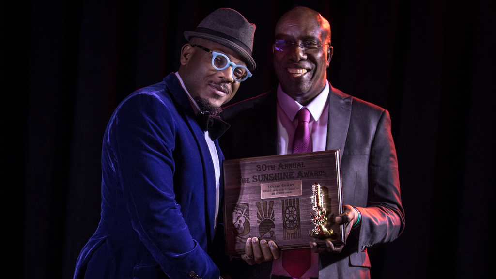 Etienne Charles receiving his Sunshine Award from John Arnold. Photos by Adrien H Tillman
