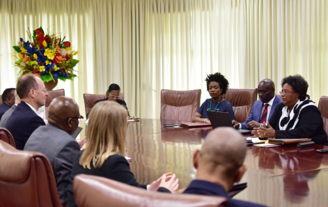 Prime Minister Mia Mottley (right) in discussion with the IMF's Bert van Selm (left) during their meeting at Government Headquarters today. To Prime Minister Mottley's right are Minister in the Ministry of Finance, Ryan Straughan and Minister in the Ministry of Economic Affairs, Marsha Caddle. (C.Pitt/BGIS)
