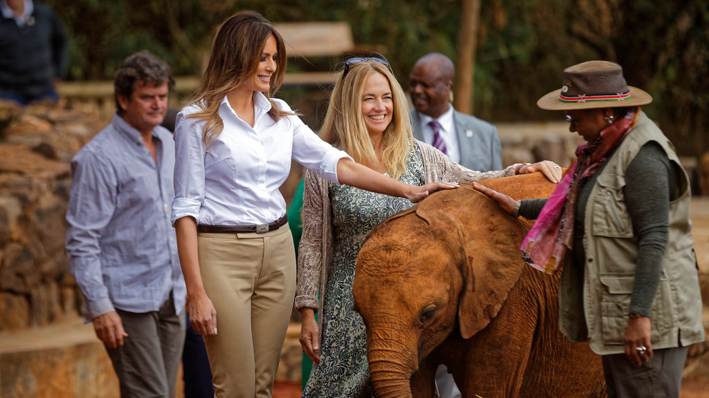 U.S. first lady Melania Trump pets a baby elephant, accompanied by CEO Angela Sheldrick, center, and Kenya's first lady Margaret Kenyatta, right, at the David Sheldrick Wildlife Trust elephant orphanage in Nairobi, Kenya Friday, Oct. 5, 2018.