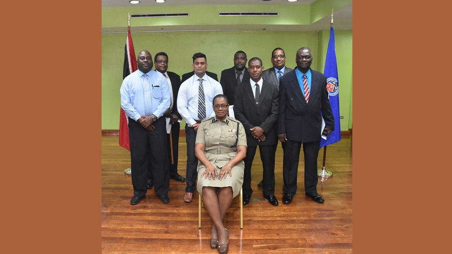 Acting DCP Erla Christopher (seated) among newly promoted First Division Officers.