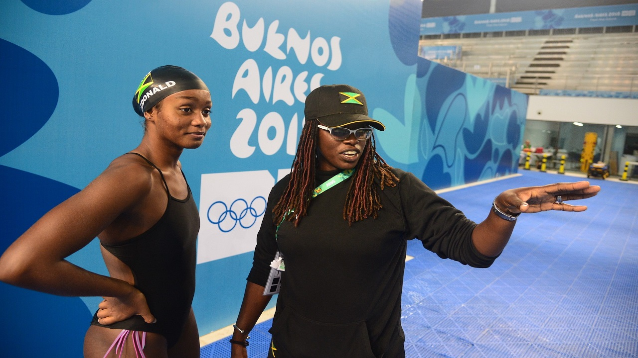 Jamaica's swimmer Emily MacDonald (left) and coach Gillian Millwood at the 2018 Youth Olympic Games inBuenos Aires,Argentina. (PHOTOS: Collin Reid courtesy of Jamaica Olympic Association).