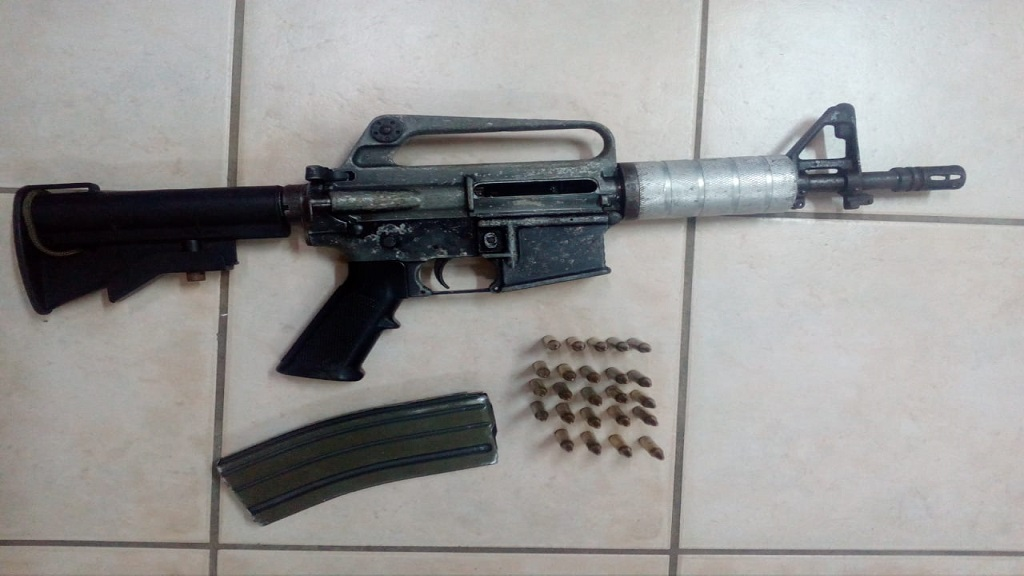 The seized M16 assault rifle and ammunition