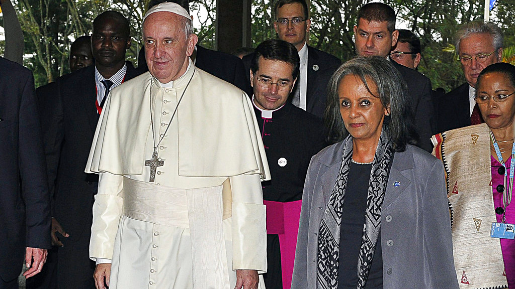 In this Nov. 26, 2015 file photo, Pope Francis walks next to then Director-General of the United Nations Office at Nairobi (UNON) Sahle-Work Zewde, right, upon his arrival there in Nairobi, Kenya. (Simon Maina/Pool via AP, File)