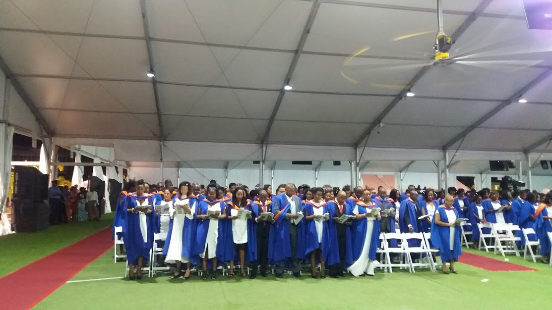 2018 graduates of the University of the West Indies (UWI) Cave Hill Campus, sing the university song.