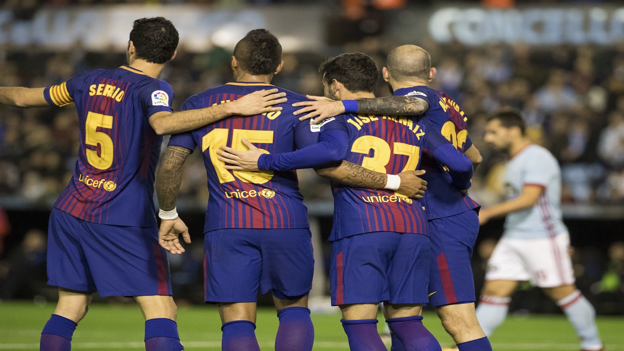 Barcelona's Jose Arnaiz, center, is congratulated by teammates after scoring a goal during a Copa del Rey round of 16, first leg football match against Celta  at the Balaidos stadium in Vigo, Spain, Thursday Jan. 4, 2018
