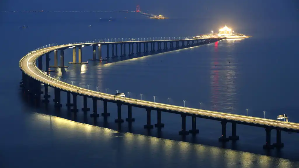 The Hong Kong-Zhuhai-Macau Bridge is lit up in Hong Kong, Monday, Oct. 22, 2018. (AP Photo/Kin Cheung)