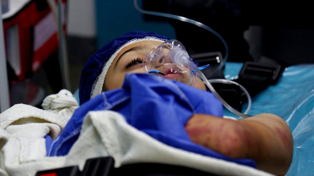 A child survivor receives medical care at a hospital near the Dead Sea in Jordan Thursday, October 25, 2018. Flash floods unleashed by heavy rains swept away a group of middle school students and teachers visiting hot springs near the Dead Sea on Thursday, killing people as the torrent carried some for several kilometers, a civil defense official said.(AP Photo/ Raad Adayleh)