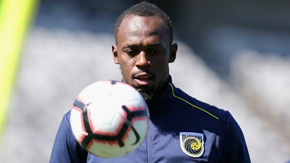 AP file photo of Usain Bolt juggling a ball during Central Coast Mariners training.