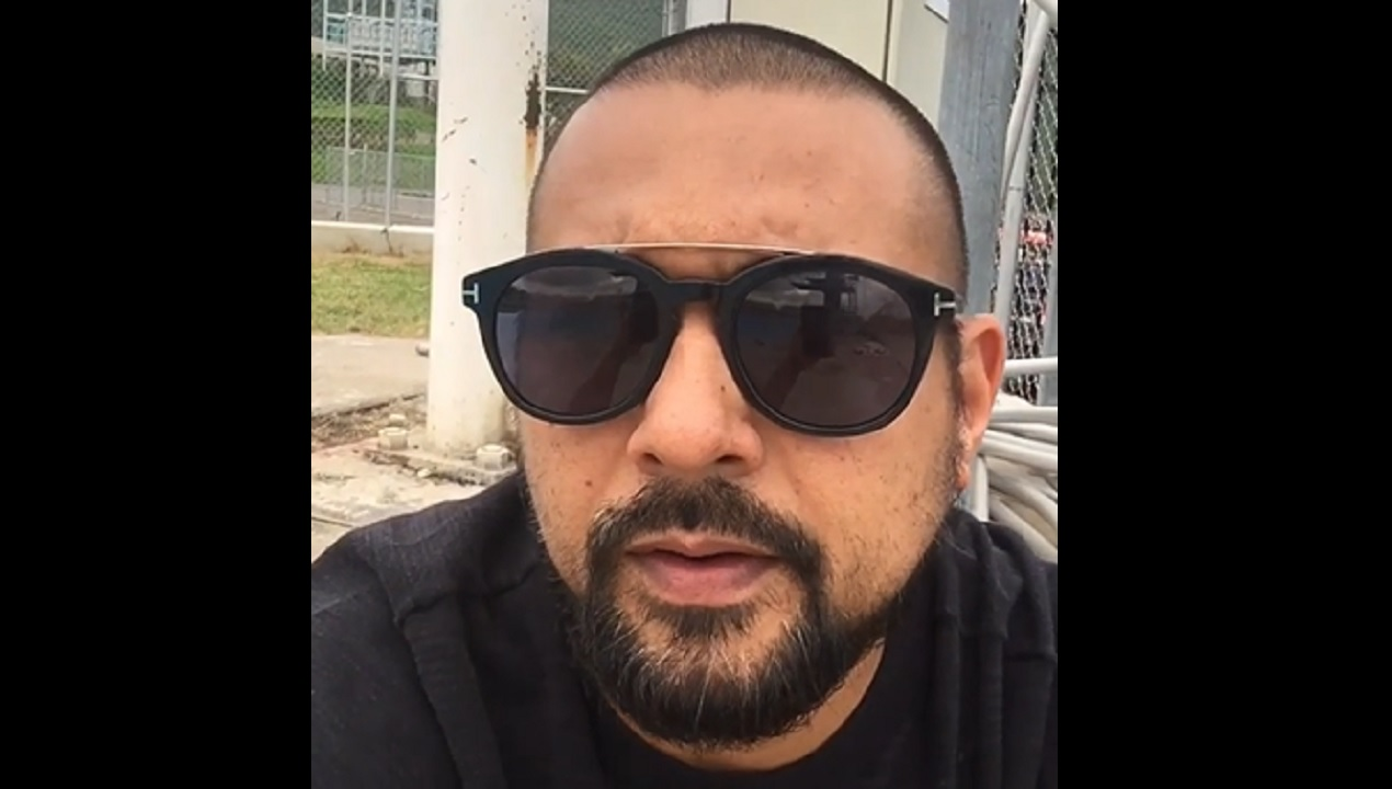 Screenshot of video showing Sean Paul voicing his concerns about the air pollution caused by the welding plant near the National Stadium pool.