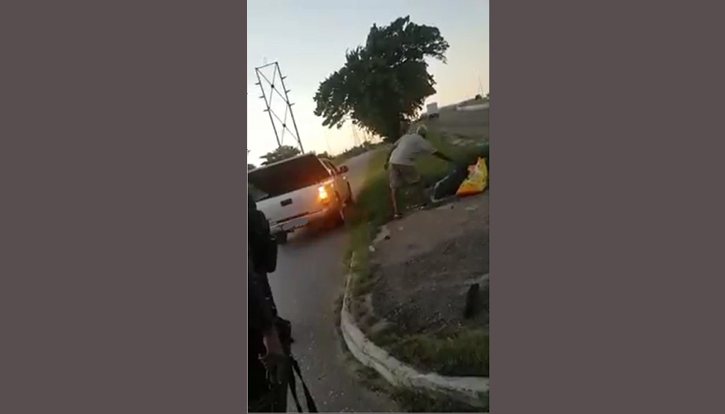 Photo taken from video footage shared online on October 29, 2018. One man was told by officers to pick up bags of rubbish which he allegedly dumped by the roadway.
