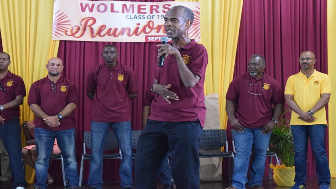 Bandele Sankofa, head of the Wolmer's Boys' School history department and a member of the institution's class of 1982, addresses Wolmerians during the handing over ceremony.