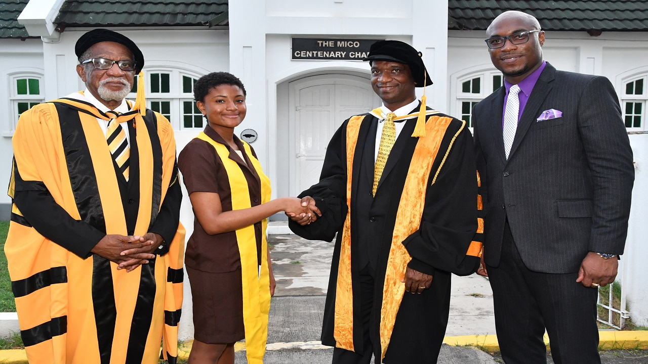 Chief Matriculant from the Faculty of Science and Technology, Nikita Danville (second left) meets with Deputy Pro-Chancellor Dr. Ryland Campbell (left), President of the MUC Dr. Asburn Pinnock (centre) and Guest speaker, Principal of Cumberland High School Darien Henry (right) after the Matriculation and Welcome Ceremony held at the Mico University College.
