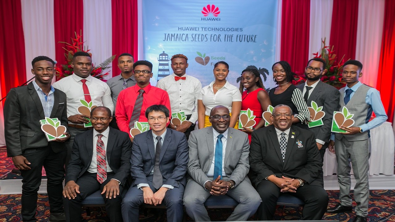 (Seated, front row, from left) UTech deputy president, Professor Colin Gyles; Huawei Jamaica country manager, Allen Chen; Education Minister Ruel Reid and UWI Mona principal, Professor Dale Webber, with the 2018 recipients of Huawei's 'Seeds for the Future' awards.