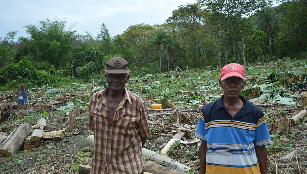 Photo: Guave Road farmers standing near their farms in 2014. Photo via Facebook.