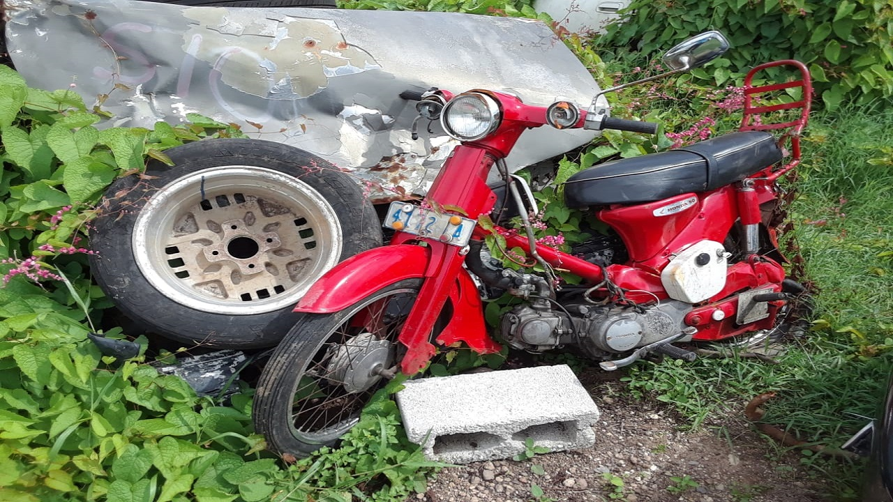The crashed Honda 50 motorbike which Sonjay McCloud was riding when he collided on the toll highway in Clarendon and later died in hospital.