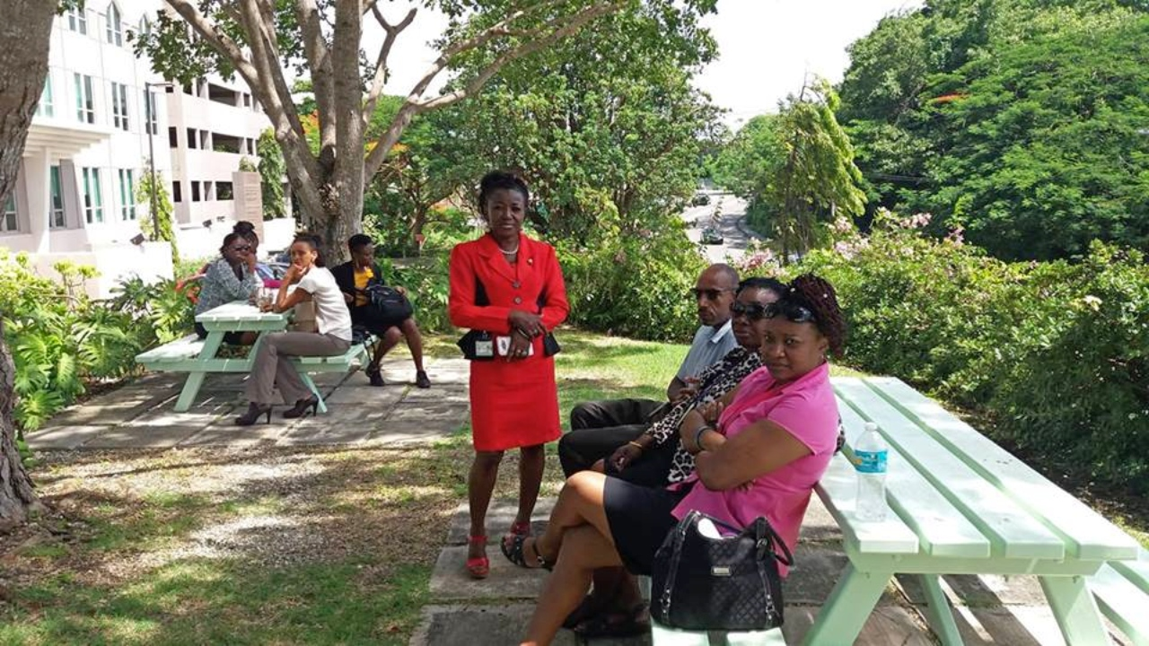 Workers at the Barbados Statistical Service (BSS) wait outside, as a pungent smell spreads across their office.