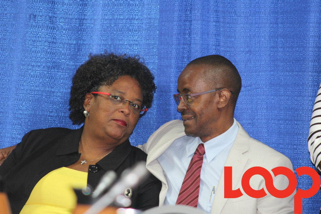 Prime Minister, Mia Mottley, in conversation with Chief Economic Counsellor, Dr. Clyde Mascoll following a Social Partnership meeting.