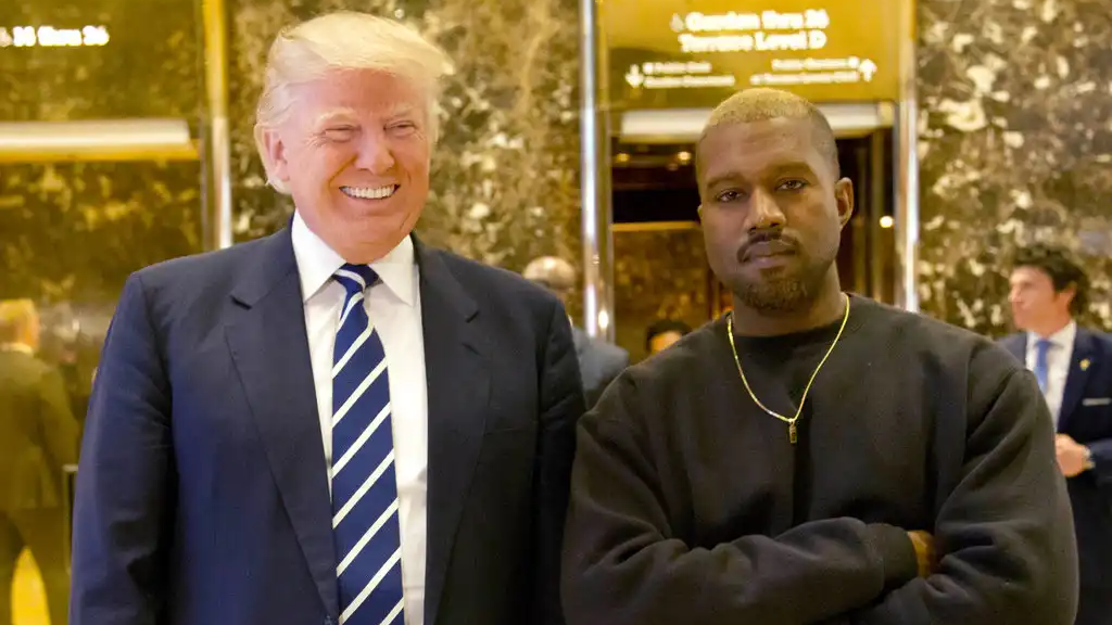 In this Dec. 13, 2016, file photo, President-elect Donald Trump and Kanye West pose for a picture in the lobby of Trump Tower in New York. (AP Photo/Seth Wenig, File)