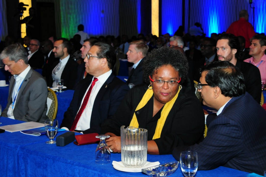 Prime Minister Mia Mottley in conversation with Professor Avinash Persaud (right) at the BItt Inc. conference. (BGIS)