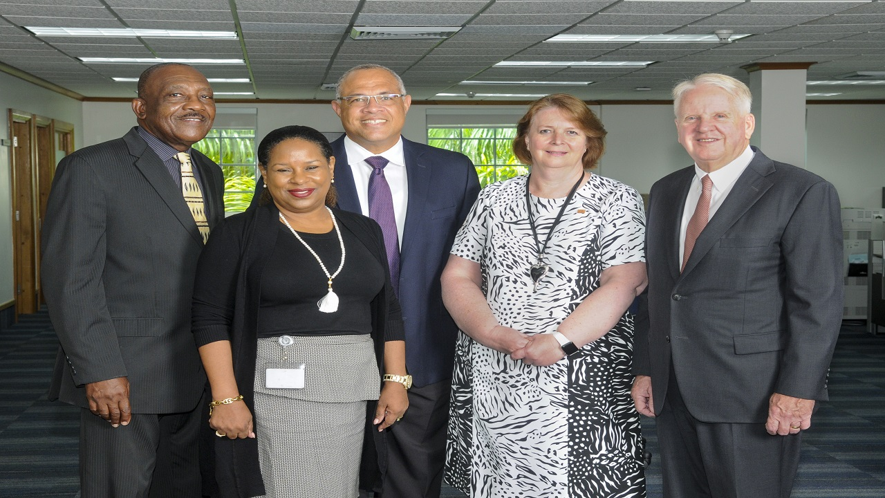 Outgoing Chief Executive Officer; Gary Brown (right) Colette Delaney, CEO Designate and new Chair of the FirstCaribbean ComTrust Foundation (second right); Mark St. Hill, Trustee and Managing Director, Retail and Business Banking, Debra King, Trustee and Director of Corporate Communications; Clenell Goodman, Trustee. Missing are: Lynda Goodridge, Trustee and overseas-based Trustees Trevor L. Torzsas and Ladesa James-Williams.