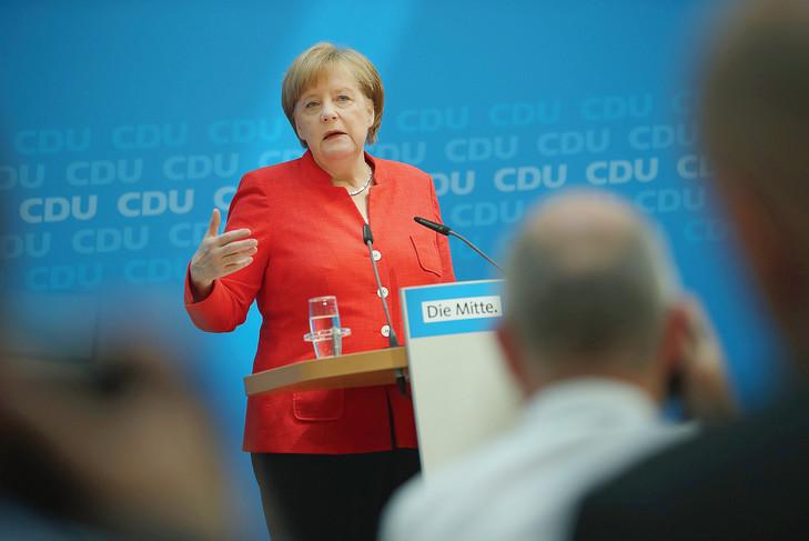 Conférence de presse de la chancelière allemande, le 18 juin à Berlin, après qu'elle a réuni dans la matinée la direction de son parti, la CDU. / S. Gallup/AFP
