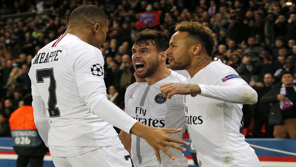 PSG defender Juan Bernat, center, celebrates after scoring his side's opening goal with teammates Neymar, right, and Kylian Mbappe during the Champions League Group C second leg  match against Liverpool at the Parc des Princes stadium in Paris, Wednesday, Nov. 28, 2018.