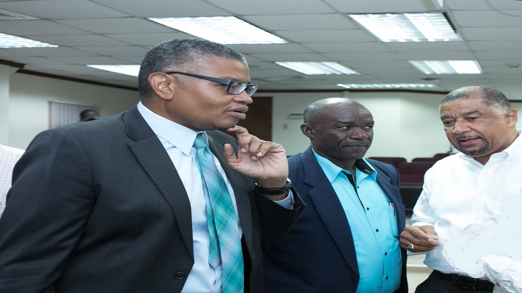 Dr. David McBean (left), Executive Director, Mona School of Business and Management (MSBM) in discussion with Hugh Johnson (centre), President, Small business Association of Jamaica and Ambassador Ralph Thomas, Director of Strategy, MSBM.