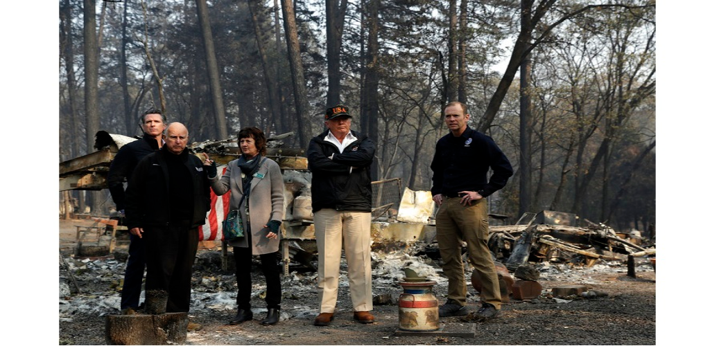President Donald Trump talks with from left, Gov.-elect Gavin Newsom, California Gov. Jerry Brown, Paradise Mayor Jody Jones and FEMA Administrator Brock Longduring a visit to a neighborhood destroyed by the wildfires, Saturday, Nov. 17, 2018, in Paradise, Calif.