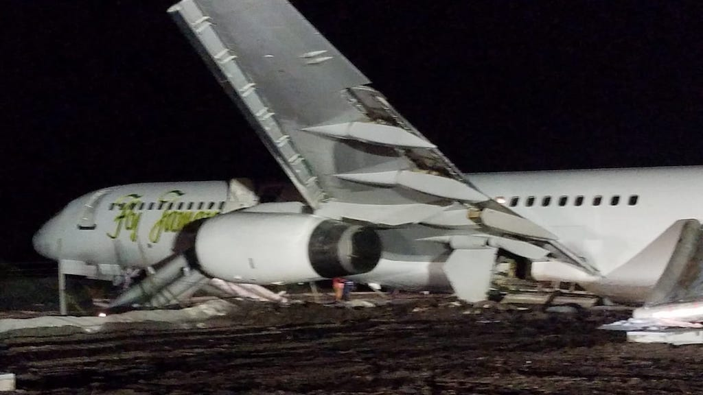 The damaged Fly Jamaica aircraft after the crash landing in Guyana.