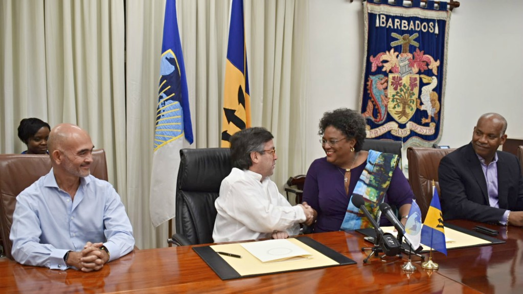 IDB President Luis Alberto Moreno shakes hands with PM Mottley.