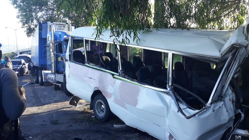 The crashed bus and trailer that were involved in the accident.