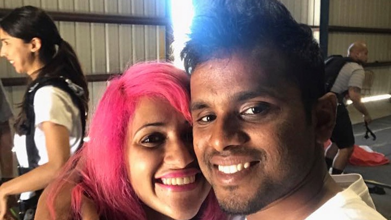 This photo obtained from Facebook posted on June 26, 2017, shows a selfie of Vishnu Viswanath, right, and his wife Meenakshi Moorthy at Skydive Santa Barbara in Lompoc, Calif. The Indian husband and wife who fell to their deaths from Taft Point, a popular overlook at Yosemite National Park, were apparently taking a selfie, the man's brother said Tuesday, Oct. 30, 2018. (Vishnu Viswanath/Facebook via AP)