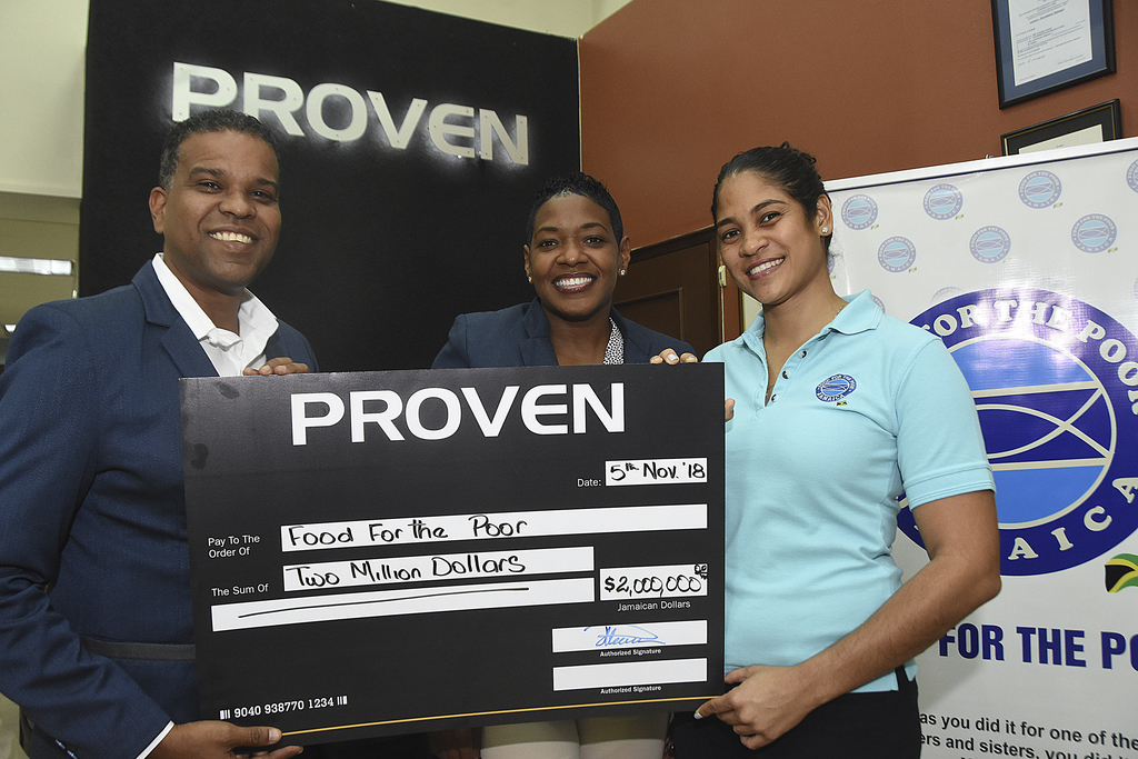 From left to right: PROVEN Wealth and PROVEN Fund Managers CEO, Johann Heaven  presents cheque to Food for The Poor, Masha Burrell-Rose Development Marketing Manager and Ms. Catherine Goodall Director for Project Development.