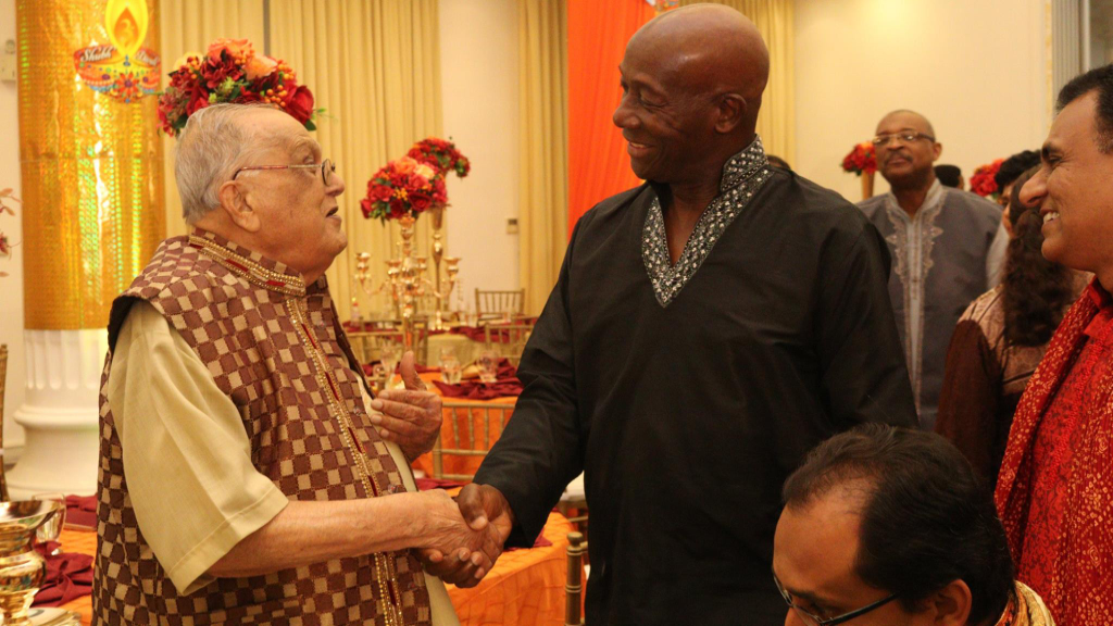 Prime Minister Dr Keith Rowley shakes hands with Secretary General of the Sanatan Dharma Maha Sabha, Sat Maharaj. Photo via Facebook, The  Office of the Prime Minister.
