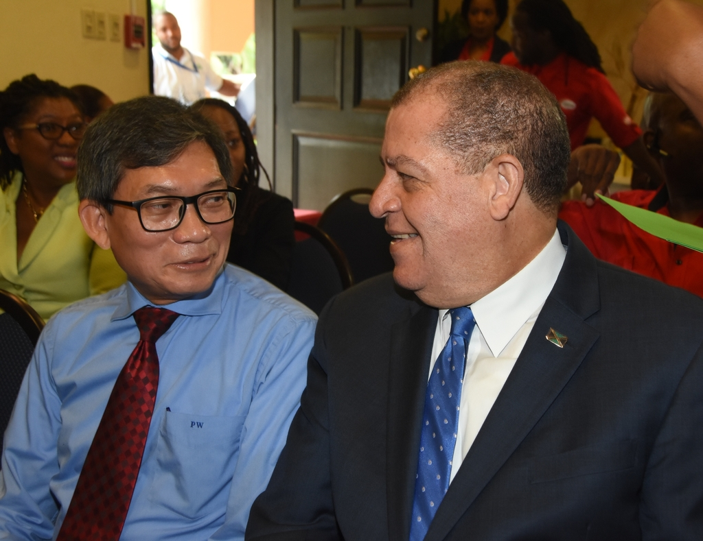 Agriculture Minister Audley Shaw (right) shares a word with Patrick Williams, Chairman of Salada Foods Jamaica at Monday's press briefing to announce the company's newest investment in the local coffee industry. (Photo: Marlon Reid).