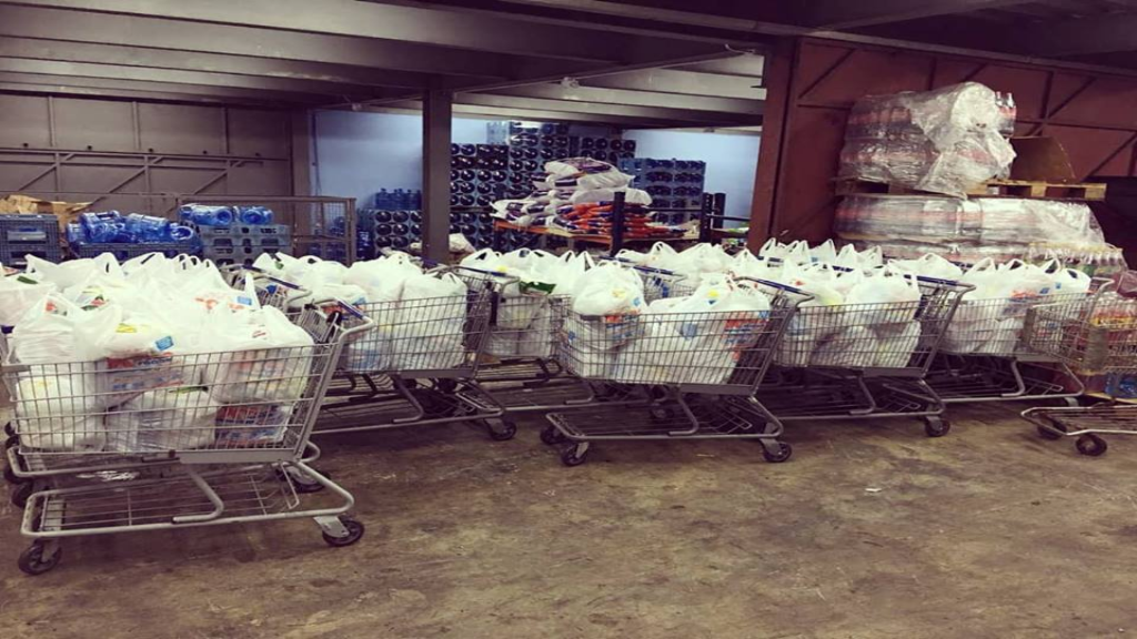 Xtra Foods packages relief items for citizens affected by devastating weekend floods. Photo via Facebook, Xtra Foods.