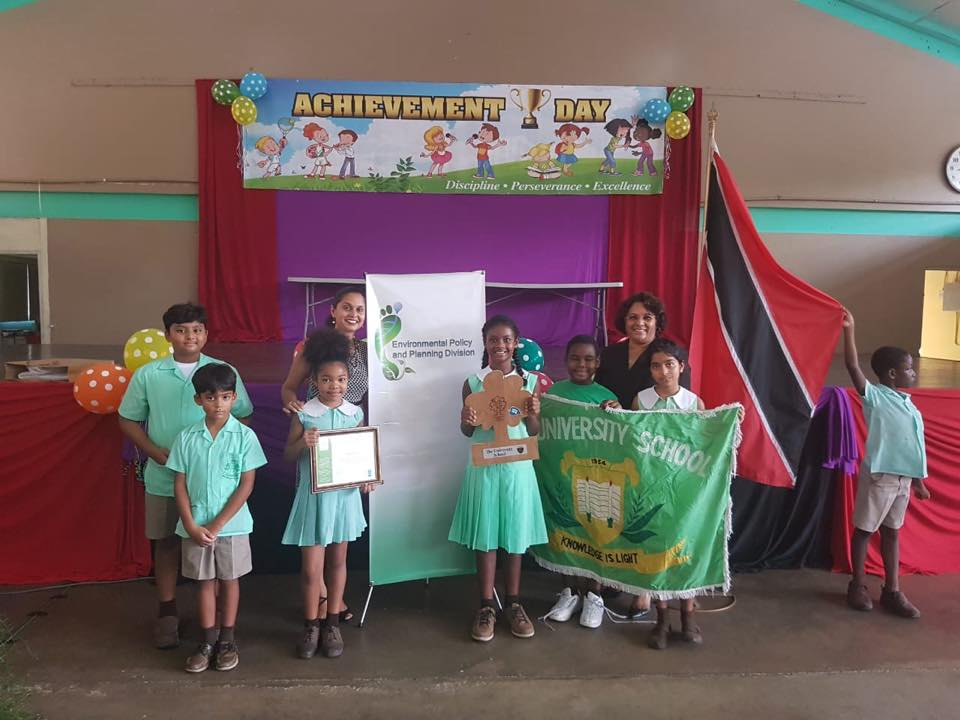 Photo: Students of The University School show their LEAF award on the importance of wetlands.