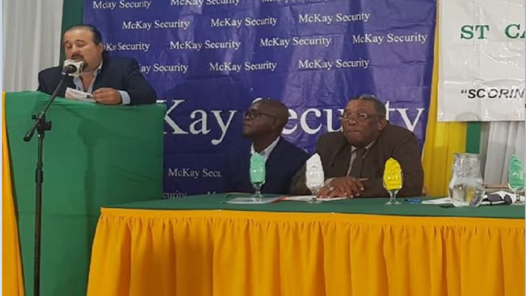 Jason McKay, chief executive officer, McKay Security, addresses the press launch of the Alliance MoneyGram-McKay Security St Catherine Football Association Major league. Seated (at right) are St Catherine Football Association president, Peter Reid, and Roy Simpson, chairman of the competitions committee.