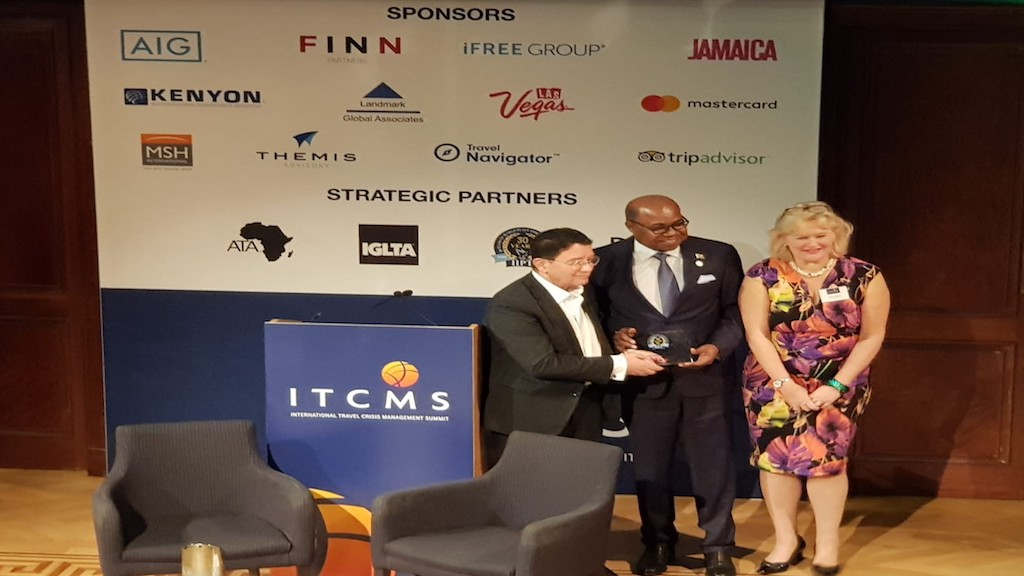 Tourism Minister Edmund Bartlett (centre) receiving the International Institute for Peace through Tourism (IIPT) Champions in Challenge Award, from former United Nations World Tourism Organization's Secretary General Dr Taleb Rifai (left).