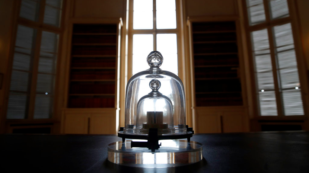 In this photo taken Wednesday, Oct. 17, 2018., a replica of the International Prototype Kilogramme is pictured at the International Bureau of Weights and Measures, in Sevres, near Paris. (AP Photo/Christophe Ena)
